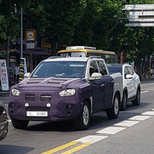 SsangYong-Q200-front-three-quarters-spy-shot